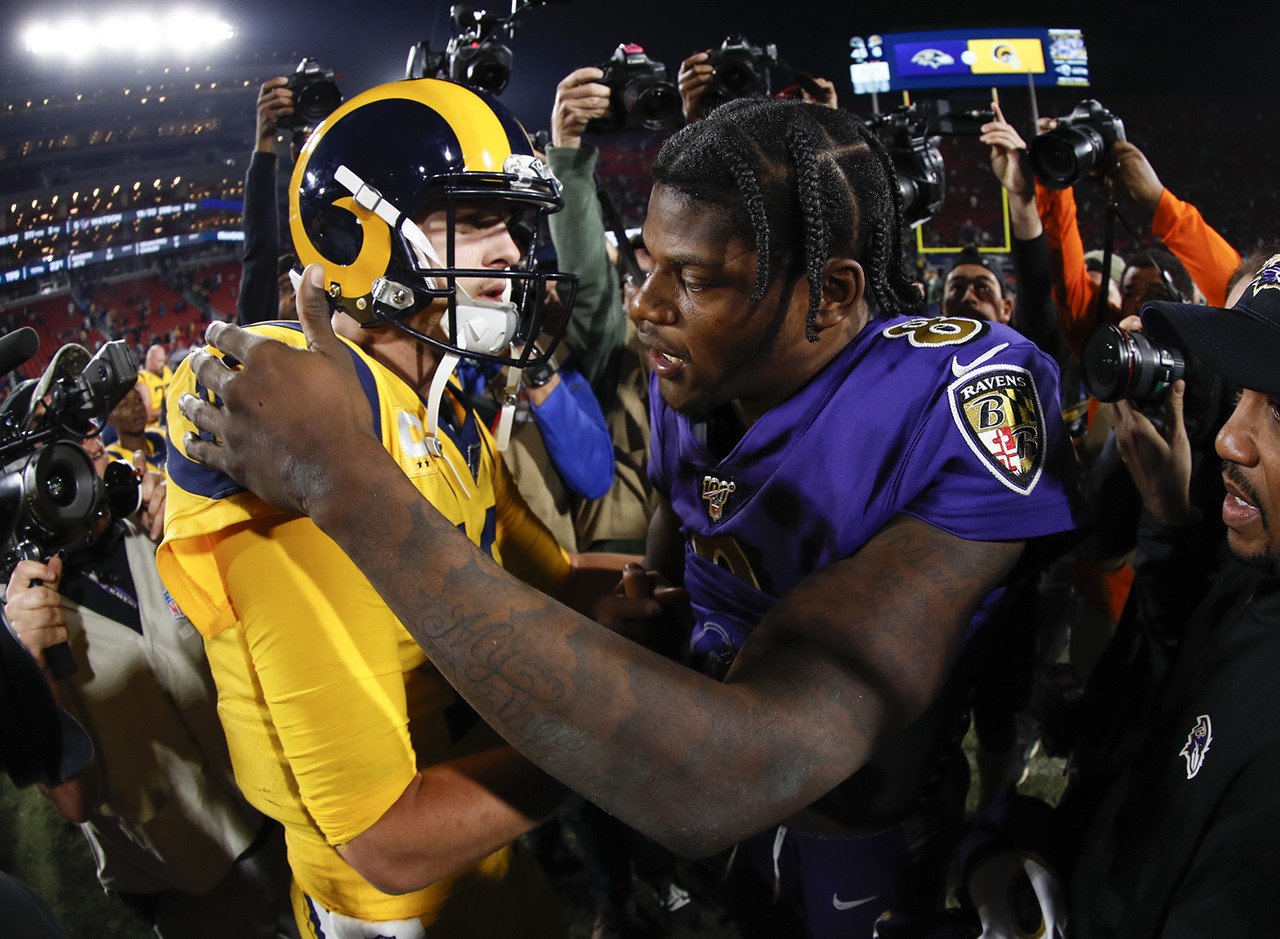 Los Angeles Rams quarterback Jared Goff (16) and Baltimore Ravens quarterback Lamar Jackson (8) hug after an NFL football game, Monday, Nov. 25, 2019 in Los Angeles.