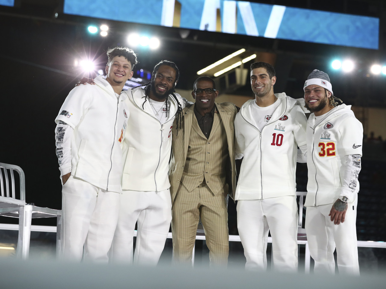 Kansas City Chiefs quarterback Patrick Mahomes (15), San Francisco 49ers cornerback Richard Sherman (25), Deion Sanders, San Francisco 49ers quarterback Jimmy Garoppolo (10) and Kansas City Chiefs strong safety Tyrann Mathieu (32) onstage during Opening Night ahead of Super Bowl LIV, Monday, Jan. 27, 2020 in Miami, Fla.