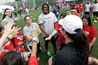 Robert Griffin III rallies participants at the 2012 NFL DRAFT PLAY 60 Youth Football Festival.