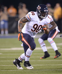 Chicago Bears DE Julius Peppers' uniform sometimes includes navy pants. Orange, however, never is an option.