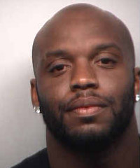 Atlanta Falcons defensive end John Abraham was booked in Fulton County Jail on Monday night on two misdemeanor charges of obstruction.