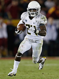 Oregon running back Kenjon Barner quickly identifies open space and blows through it.