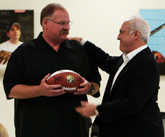 Eagles chairman/CEO Jeffrey Lurie (right) presents Andy Reid with a special game ball during a Monday ceremony.