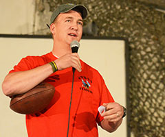 Denver Broncos quarterback Peyton Manning speaks to U.S. troops in Afghanistan on Friday. (Staff Sgt. David J. Overson, U.S. Army/Associated Press)