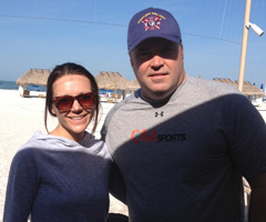 Coach Mike McCarthy poses with Tim Schlosser's girlfriend, Abigail Kobriger, on the beach of Marco Island, Fla.