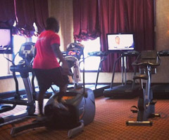Marcus Lattimore rides an exercise bike while watching the Aaron Hernandez arraignment.