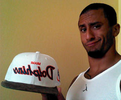 San Francisco 49ers quarterback Colin Kaepernick caught flak on social media for wearing a Miami Dolphins hat. (@kaepernick7/Instagram)