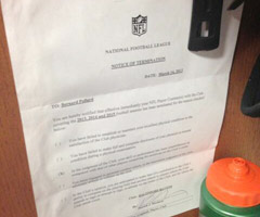 Bernard Pollard's notice of termination from the Baltimore Ravens is on display in his locker with the Tennessee Titans.