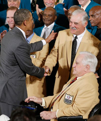Larry Csonka, leading rusher for the 1972 Dolphins, receives a hearty handshake from President Barack Obama.