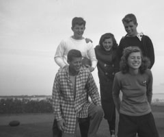 John F. Kennedy (lower left) always enjoyed the family football games that frequently took place at their Massachusetts home.