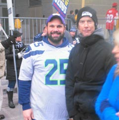 Duff McKagan poses with a fan outside CenturyLink Field before the NFC Championship Game.