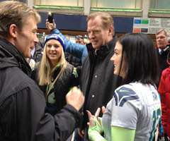 NFL Commissioner Roger Goodell gives Super Bowl tickets to Nicole Hill and Sarah Agerup, who had tickets to the game but lost them when the wallet they were in was stolen. (Courtesy NFL PR)