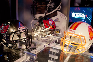 The Bucs' new helmet (center) is seen with its two predecessors. (Alix Drawec/NFL)