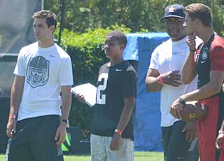 Chase Griffin, a 13-year-old QB prodigy, took notes while watching top passing prospects go through drills.