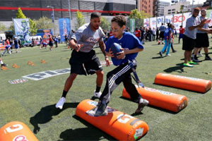 Cody Latimer leads kids through PLAY 60 drills at the 2014 NFL DRAFT PLAY 60 Youth Football Festival. (AP)
