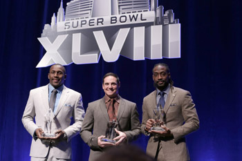 The 2013 Walter Payton NFL Man of the Year Finalists, Carolina Panthers' Thomas Davis, Arizona Cardinals' Jay Feely and Chicago Bears' Charles Tillman, at Super Bowl XLVIII.
