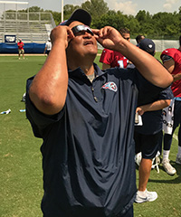 Titans offensive coordinator Terry Robiskie dons his protective eclipse-viewing glasses. (Michael Silver/NFL.com)