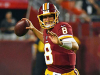 Cousins, Thompson lead Redskins' romp over Raiders