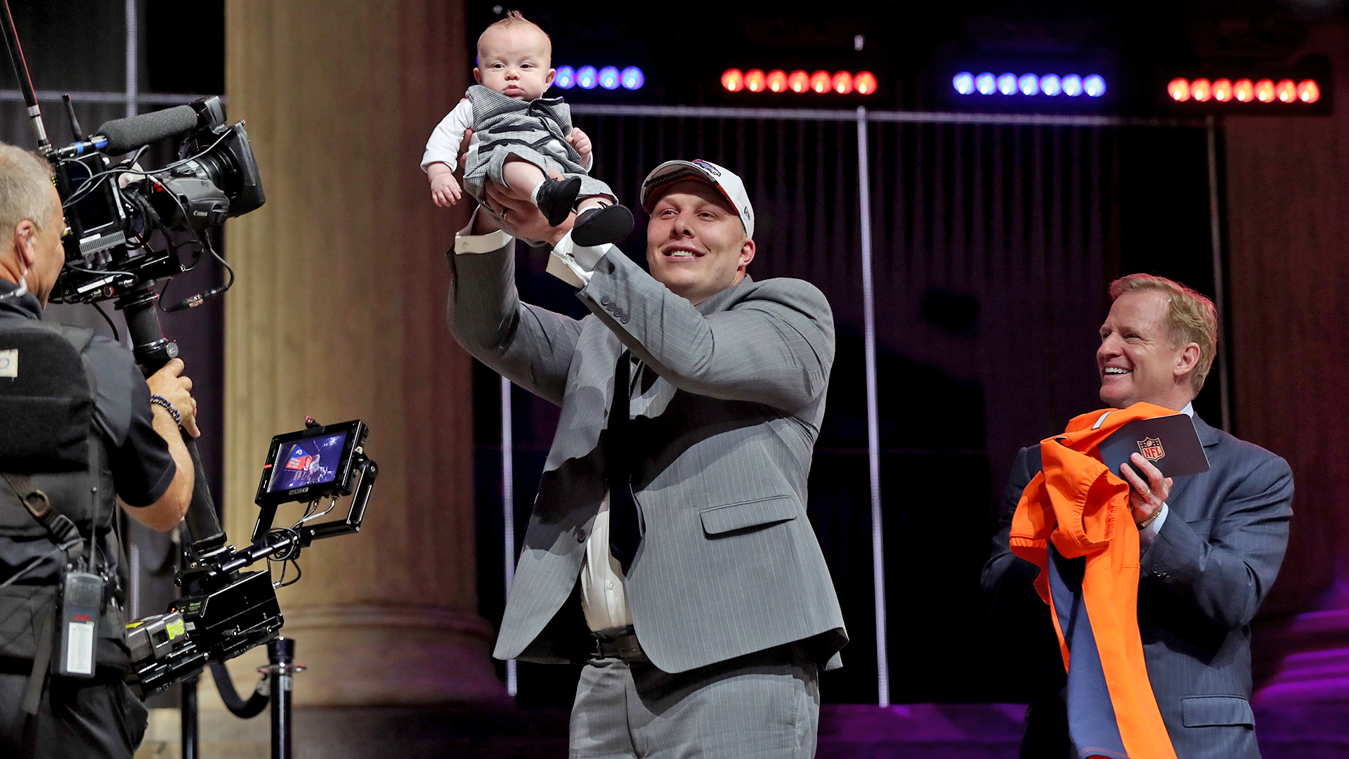 Utah offensive tackle Garett Bolles holds his son Kingston after being selected by the Denver Broncos with the 20th pick during the first round of the 2017 NFL Draft on Thursday, April 27, 2017 in Philadelphia. (Perry Knotts via AP)