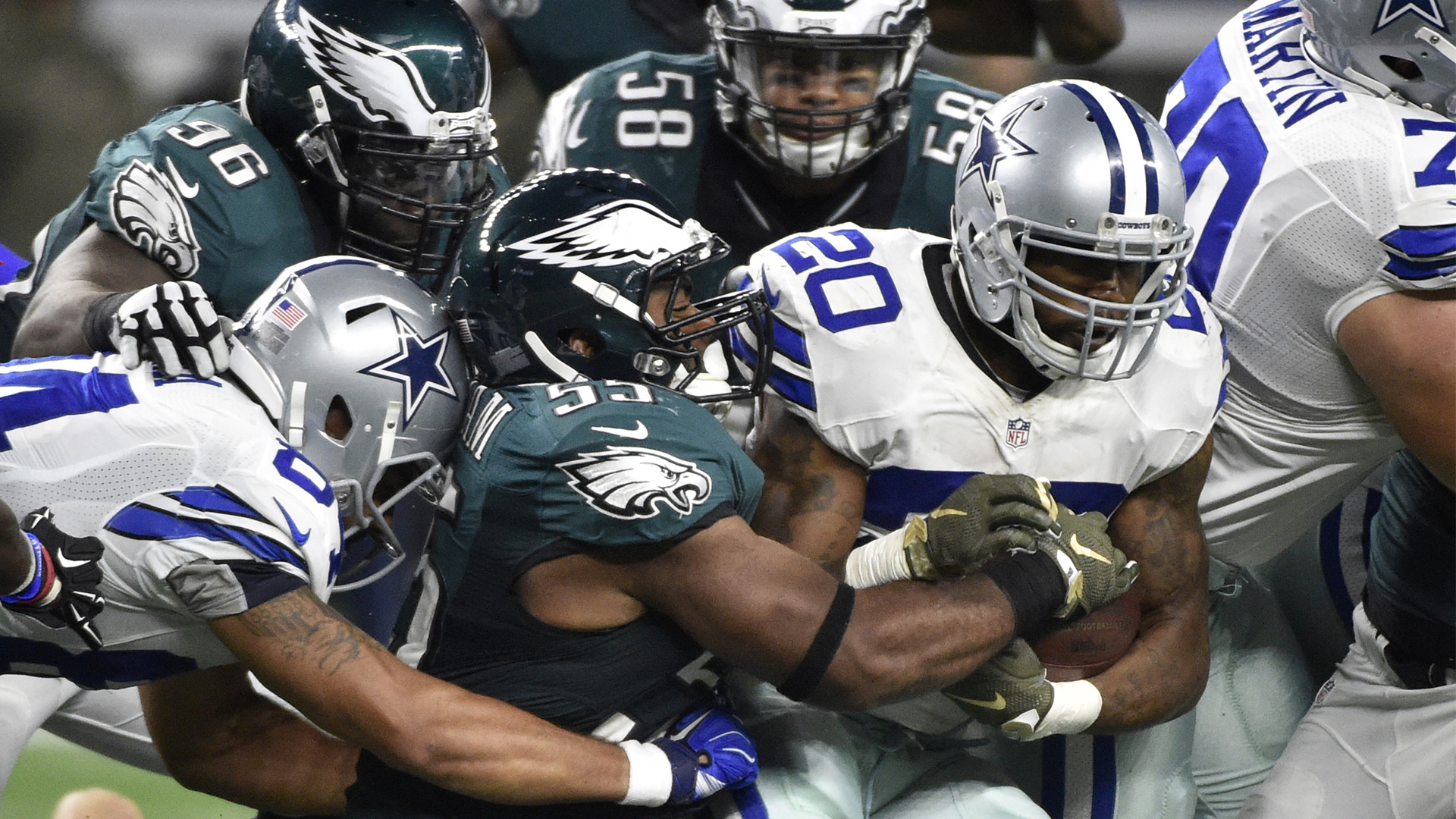 Philadelphia Eagles' Brandon Graham (55), Jordan Hicks (58) and Bennie Logan (96) attempt to tackle Dallas Cowboys' Darren McFadden (20) on a run in the second half of an NFL football game Sunday, Nov. 8, 2015, in Arlington, Texas. (AP Photo/Michael Ainsworth)