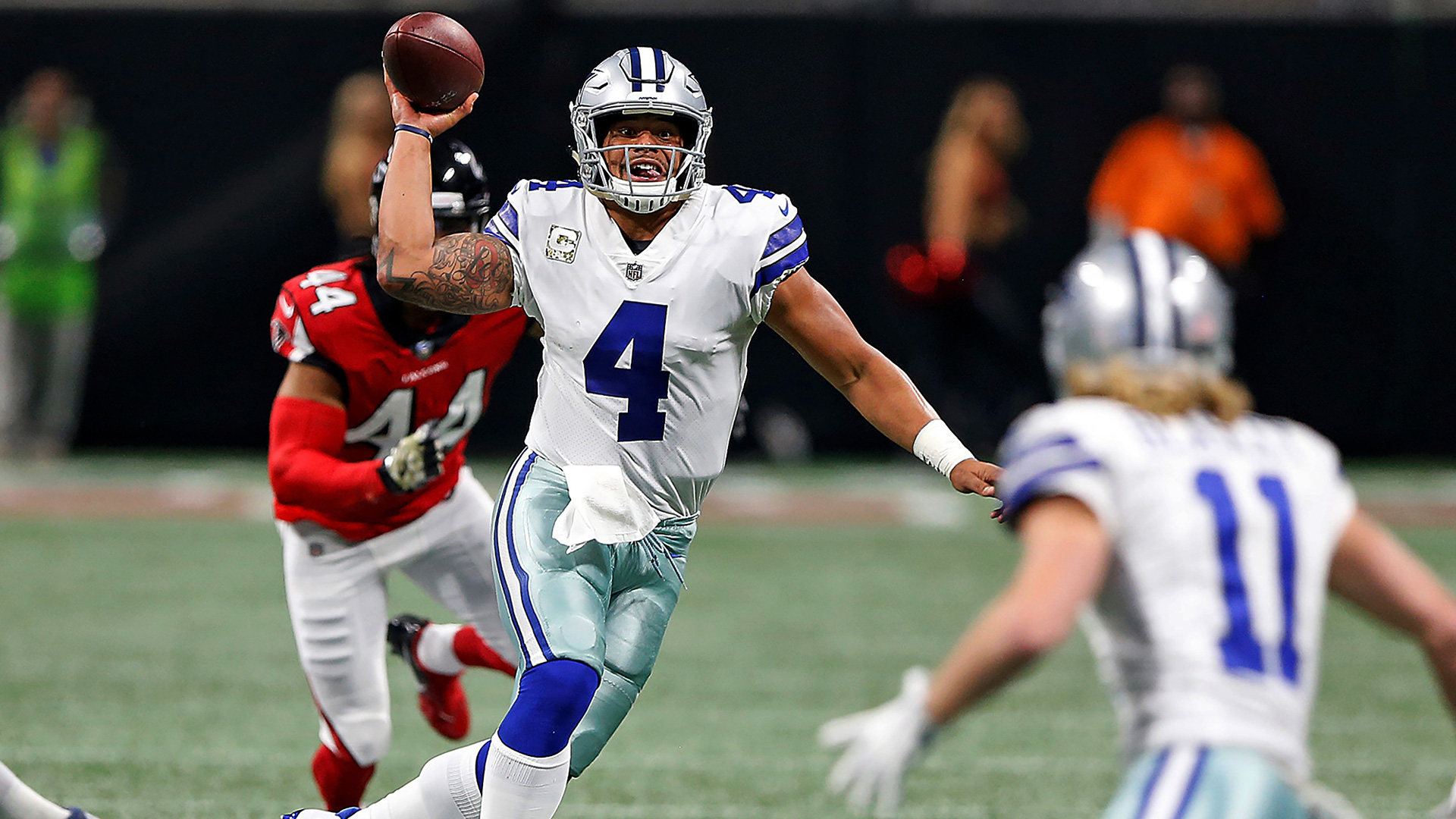 Dallas Cowboys quarterback Dak Prescott (4) scrambles up the middle during a 2017 NFL week 10 regular season game against the Atlanta Falcons, Sunday, Nov. 12, 2017 in Atlanta, Ga.  The Falcons defeated the Cowboys, 27-7.  (James D. Smith via AP)
