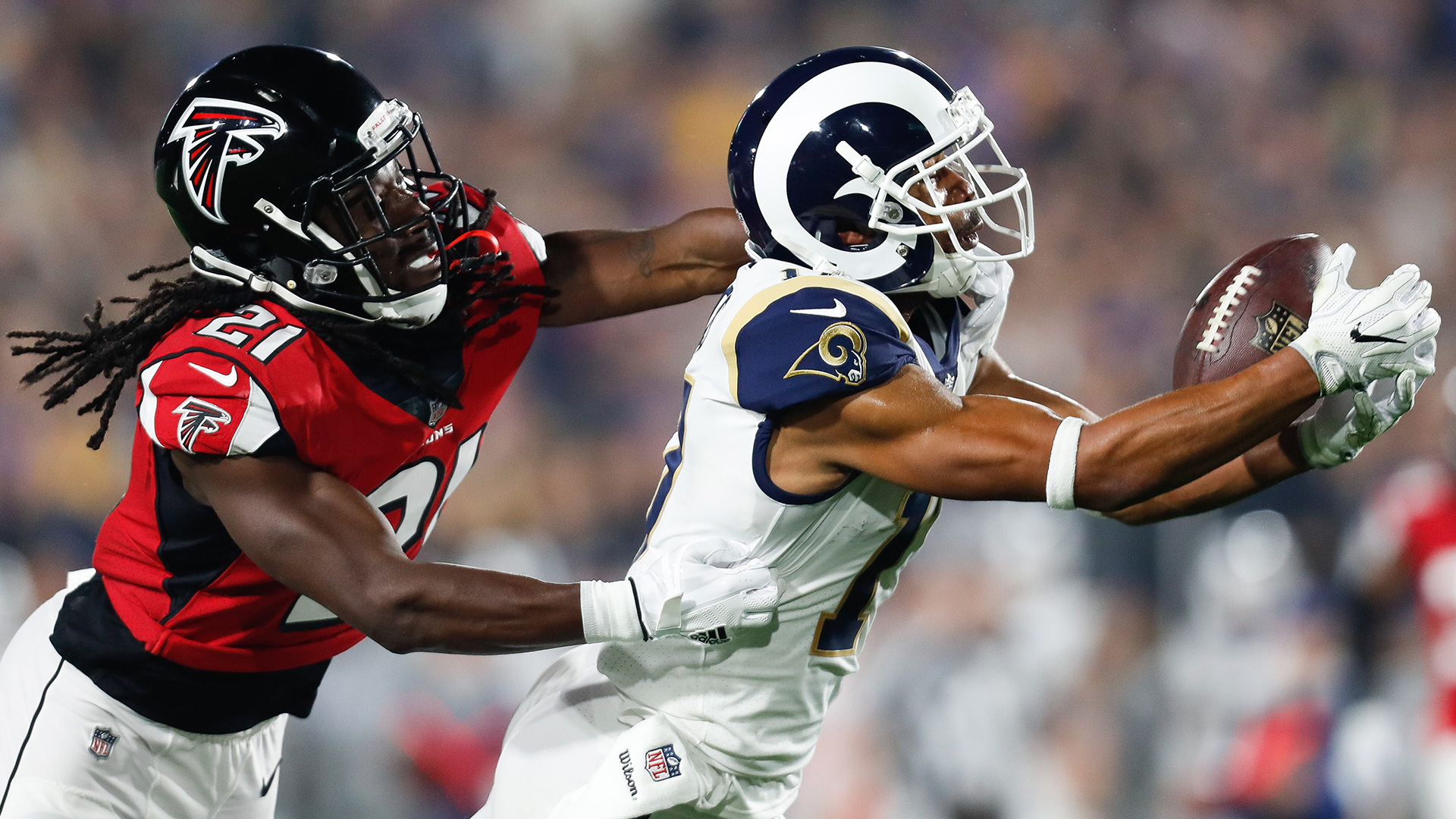 Los Angeles Rams wide receiver Robert Woods (17) catches the ball in front of Atlanta Falcons cornerback Desmond Trufant (21) during an NFL football NFC wild card playoff game.