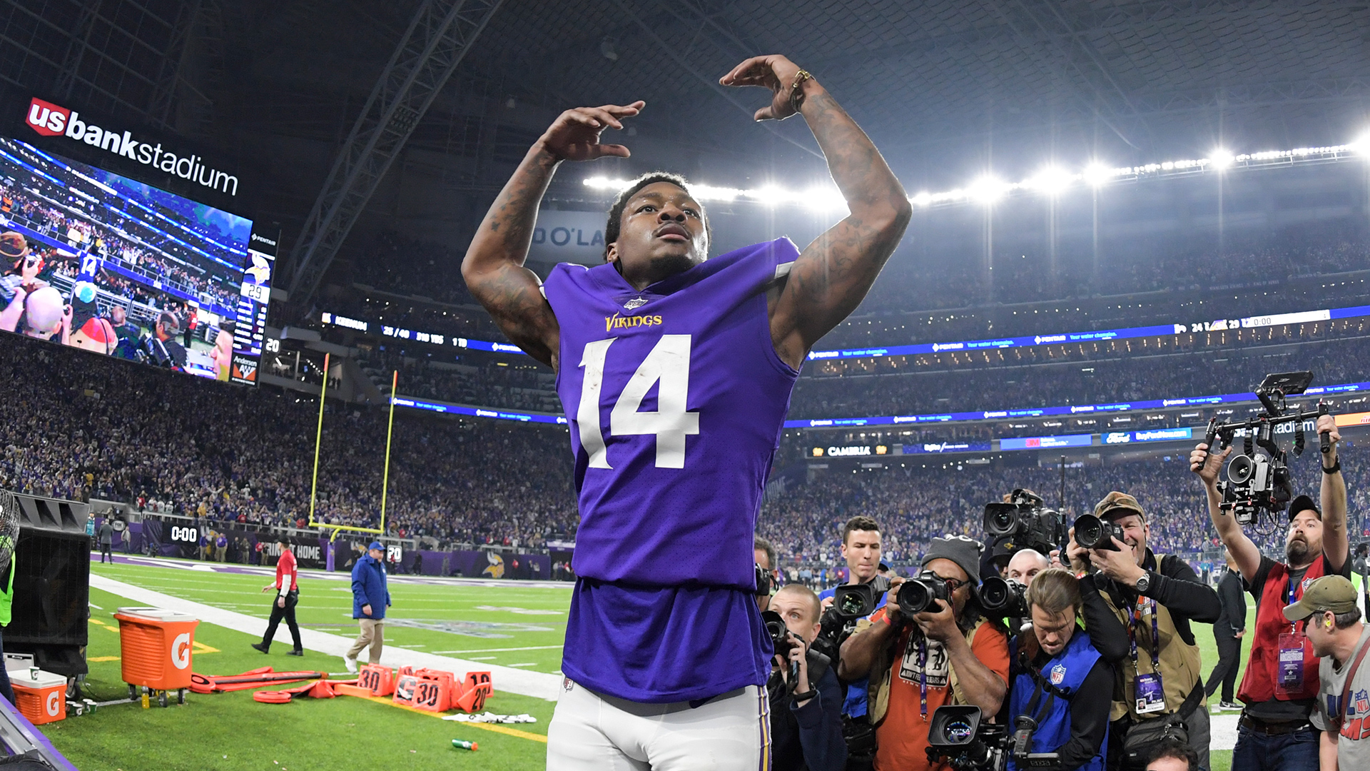 Minnesota Vikings wide receiver Stefon Diggs (14) gestures to the crowd, celebrating a last-second touchdown reception during an NFC Divisional playoff game in Minneapolis allowing the Vikings to advance into the NFC Championship game against the Eagles.