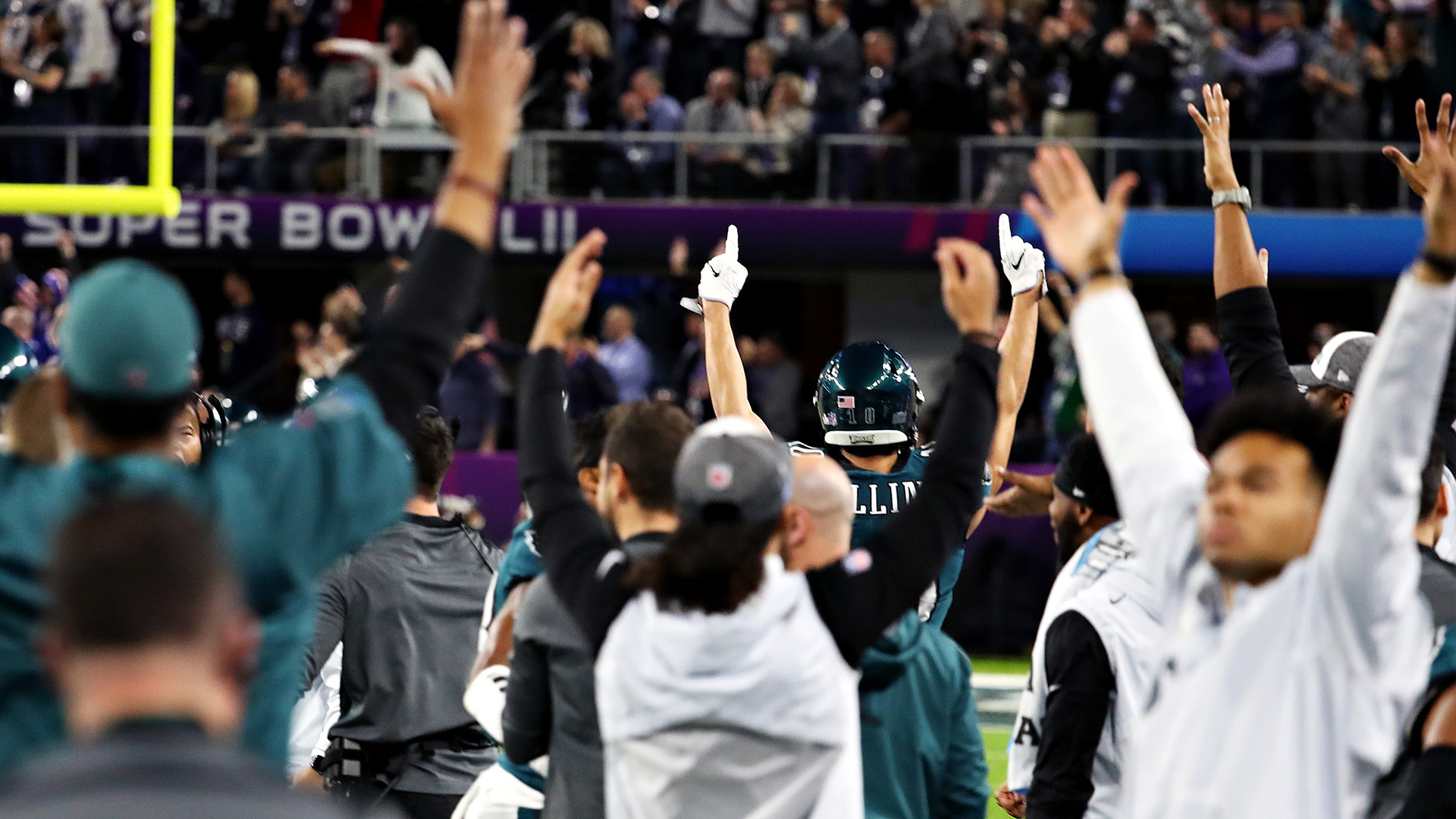 The Philadelphia Eagles celebrate on the sideline.