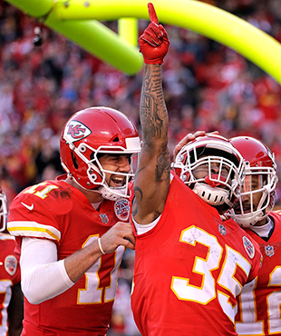 Kansas City Chiefs running back Charcandrick West (35) celebrates his touchdown against the Oakland Raiders with wide receiver Tyreek Hill (10), quarterback Alex Smith (11) and wide receiver Albert Wilson (12) during the second half of an NFL football game in Kansas City, Mo., Sunday, Dec. 10, 2017. (AP Photo/Charlie Riedel)