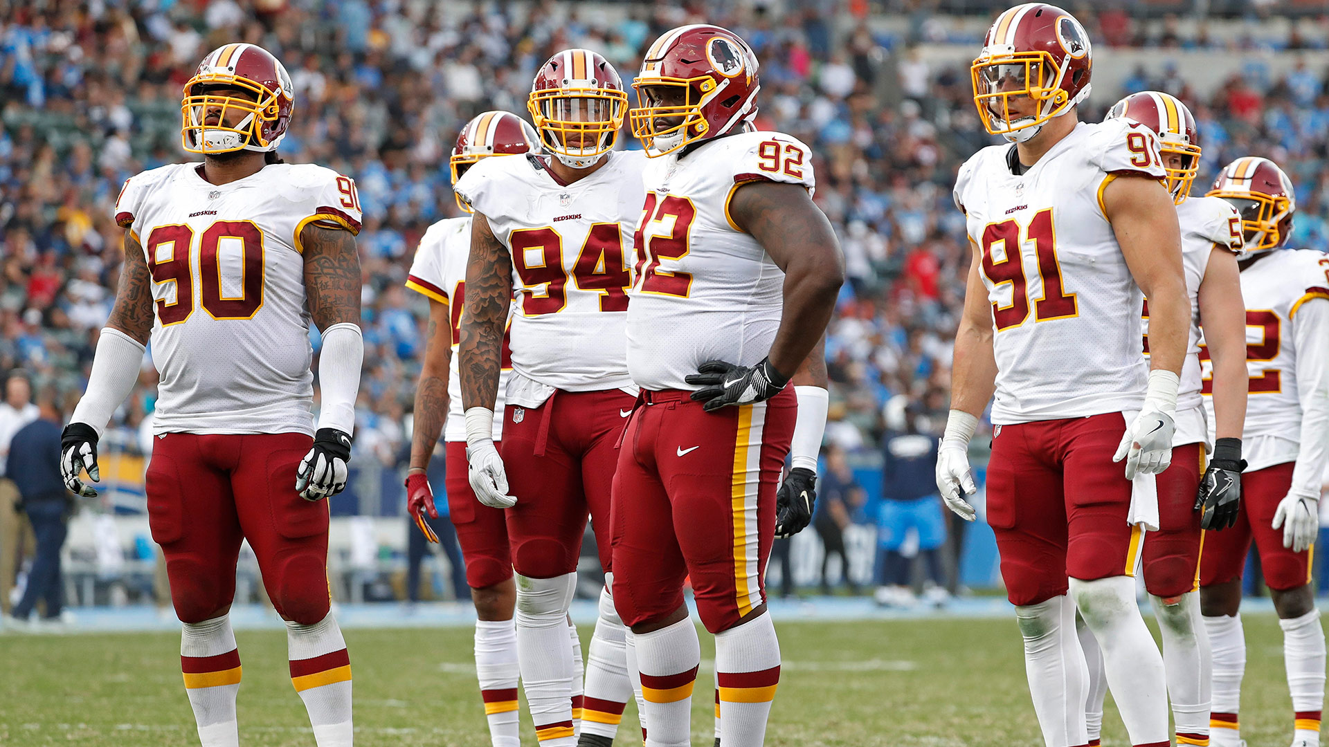 Washington Redskins defensive lineman Ziggy Hood (90), linebacker Preston Smith (94), defensive lineman Stacy McGee (92) and linebacker Ryan Kerrigan (91) wait for the snap  during an NFL football game against the Los Angeles Chargers on Sunday, Dec. 10, 2017 in Carson, Calif. The Chargers won the game, 30-13. (Greg Trott via AP)