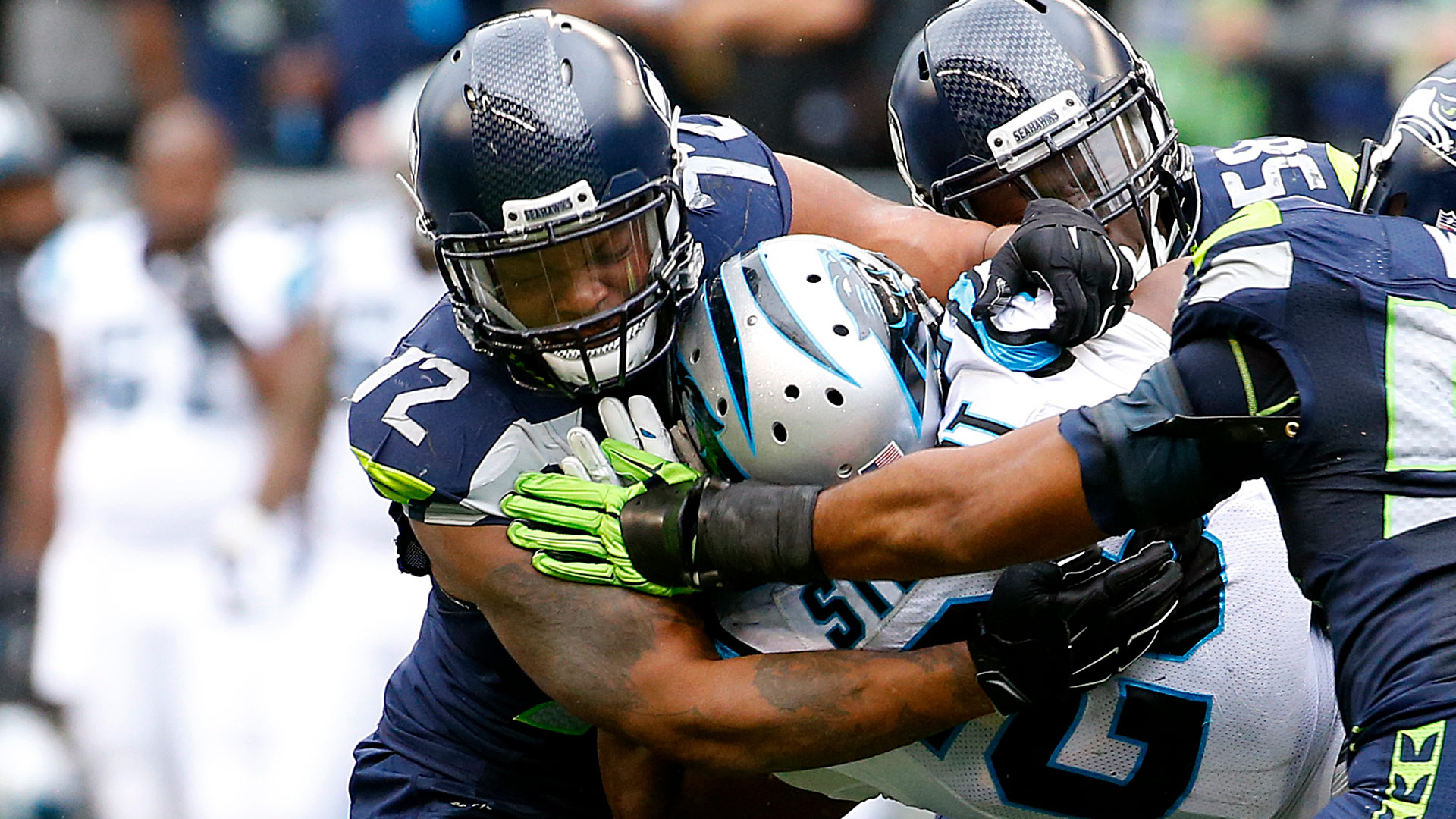 Seattle Seahawks defensive end Michael Bennett (72), safety Earl Thomas (29) and linebacker K.J. Wright (50) team up to stop Carolina Panthers running back Jonathan Stewart (28) during an NFL game  at CenturyLink Field on October 18, 2015. The Panthers defeated the Seahawks 27-23. (Kevin Terrell via AP)