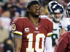 Video - Washington Redskins quarterback Robert Griffin III leaves game after re-injuring knee