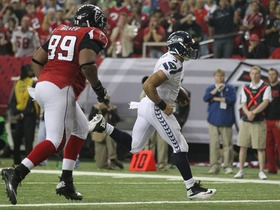 Video - Seattle Seahawks quarterback Russell Wilson scores on a 1-yard touchdown run