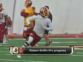 Watch: RGIII running gingerly on rollout passes