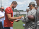 Watch: Troops visit Titans camp