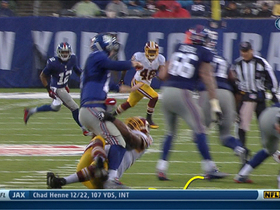 Eli Manning injures ankle, but stays in and throws an interception