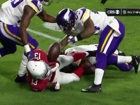 Cardinals Carson Palmer dodges rush to get pass off