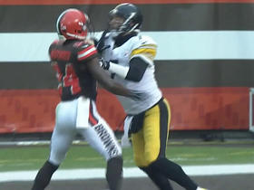 Ben Roethlisberger tussles with defender after interception
