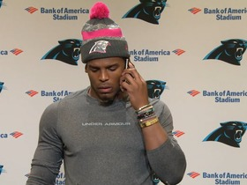 Watch: Cam answers his phone during a press conference