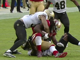 Kenny Vaccaro rips ball away from DuJuan Harris