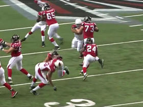 Devonta Freeman evades defenders for a gain of 16 yards