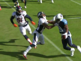 DeMarco Murray shows his stiff arm to Chris Harris