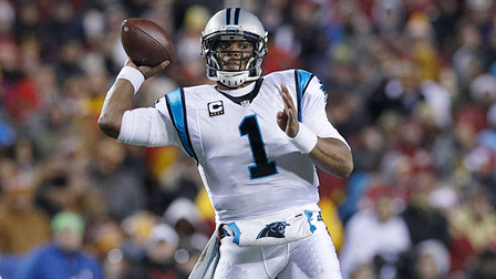 Cam Newton completes a pass under pressure to Ed Dickson ...
