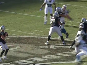 Derek Carr fires a pass to Andre Holmes for 22 yards