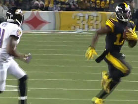 Eli Rogers flies into kicking net after a 39-yard catch and run