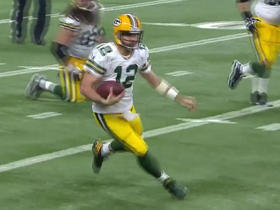 Aaron Rodgers dances around for a gain of 12 yards