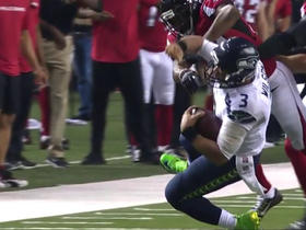 Watch: Russell Wilson takes hit from Brian Poole on 11-yard scramble