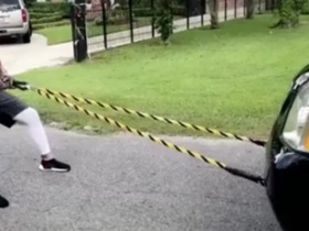 Watch: Duke Riley shows off strength by pulling massive SUV down the street
