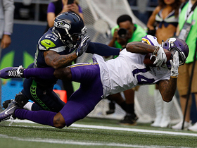 Watch: Stefon Diggs holds on to the football while being tackled by Earl Thomas