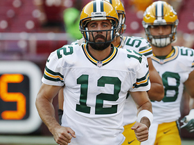 Watch: Aaron Rodgers uses his feet and scrambles for 15 yards